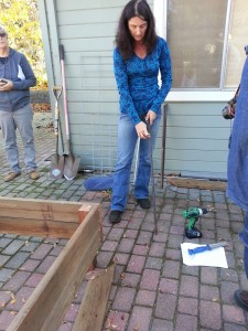 6. Making a garden box: Concrete stakes get attached to each corner -- (easier to level bed than putting the bed).